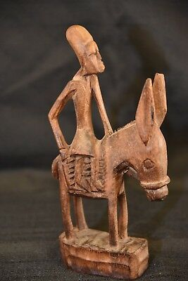 Vintage 1960's African hand carved wood person riding a donkey statue