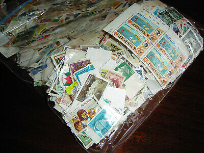 World job lot    200 grams mixed collection  off paper stamps