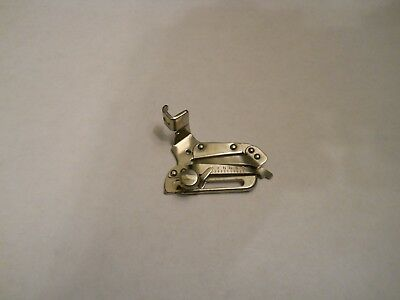 Singer sewing machine replacement part #35931 - adjustable hemmer - (pre-owned)
