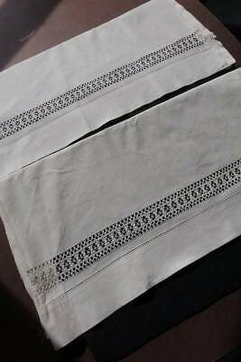 Pair vintage white cotton pillowcases with drawnthread hems.