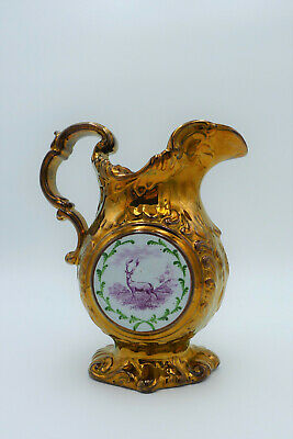 Victorian copper luster -clock and stag- jug.