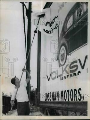 1959 Press Photo Man Posting Billboard - nef15475