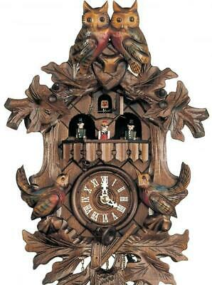 Hand-carved cuckoo clock with mechanical 1-day-movement and music (with moving .