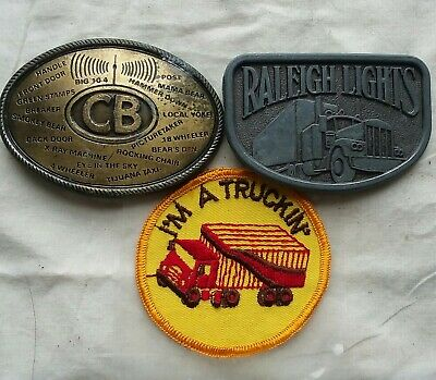 Vintage trucking belt buckles, CB and Raleigh Lights. Plus patch.