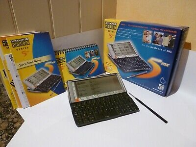 Psion 5MX working boxed with original manual and modem/serial cable.