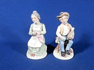 Vintage Porcelain Sitting Old Man with a Bottle and Woman Sewing Socks Figurines