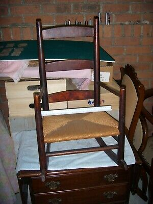Antique Wicker Child Rocking Chair. Excellent condition. Brown wood.
