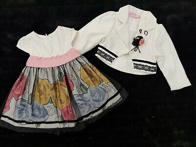 Stunning two piece baby girls dress and jacket cream and black