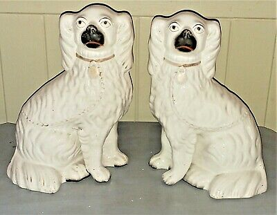 Pair of Antique White Staffordshire Spaniels with Separate Front Legs C 1850