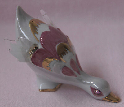 Bird Bending Down White With Pink And Gold Decoration Clear Wing Tips