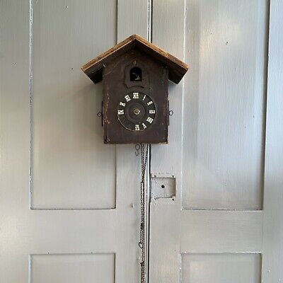 Vintage wooden wall mounted cuckoo clock