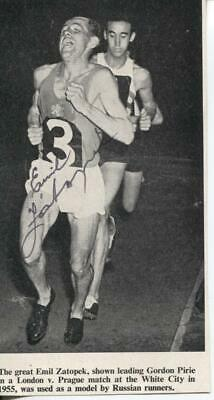 A magazine picture featuring and personally signed by athlete Emil Zatopek.
