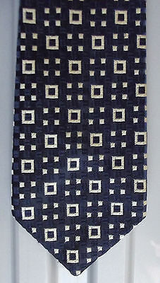 Vintage 1970s tie with white squares on navy blue background woven check pattern