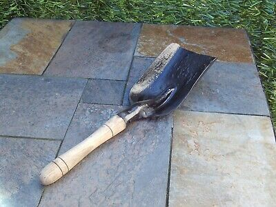 Old fire shovel with wooden handle