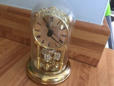 Small Glass Dome JUNGHANS Quartz Mantel Clock With Decorative Spinning Feature
