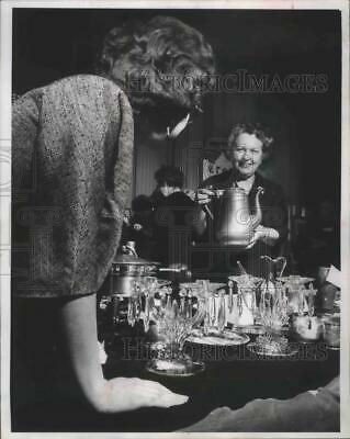 1963 Press Photo Mrs. Conrad Elvejem Serving at Booth For Charity - mja99952