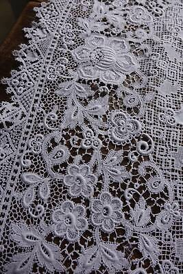 Exceptional antique snow white Irish linen tablecloth with superb lace borders.