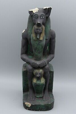 Rare seated Anubis holding a mummy form, with a baboon resting between his legs