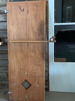 Handcrafted kitchen cupboard door By John Shipton / Julian Assange