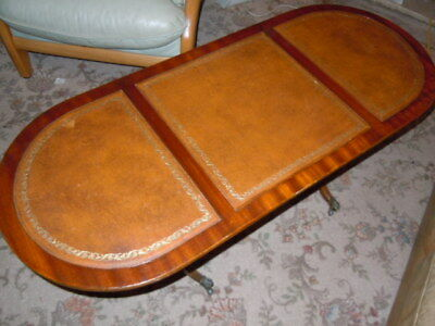 Antique Vintage Long leather top table with brass casters feet, coffee table