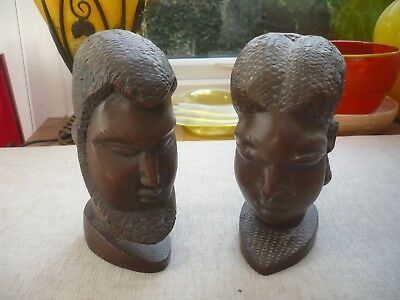 Pair of Antique African heads wooden of man and woman well carved man has beard