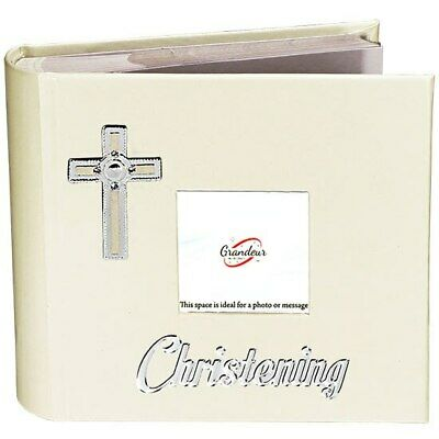 White leather photo album with photo space on front cover and metal enamel lo...