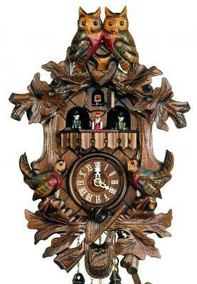 Hand-carved cuckoo clock with quartz-movement and music (with moving dancers), .