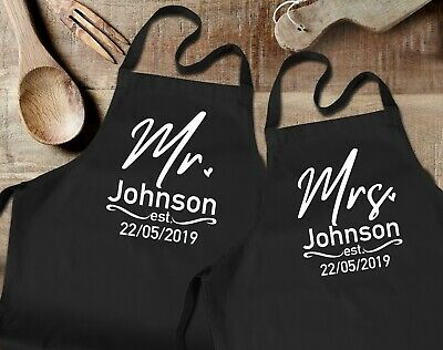 Custom surname Mr and Mrs black aprons set with custom wedding date.