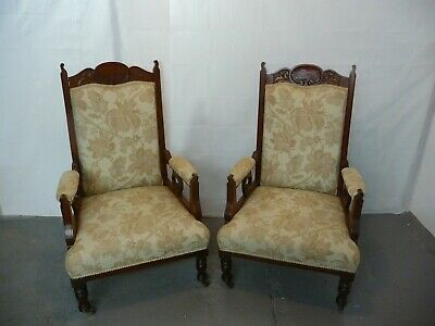 A Pair Of Late 19th Century Carved Walnut Library Armchairs