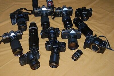 A Collection Of Vintage Film Cameras And Lenses #15
