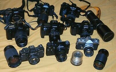 A Collection Of Vintage Film Cameras And Lenses #17