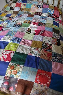 Vintage multi-coloured patchwork quilt  made up of 1920's and later fabrics.