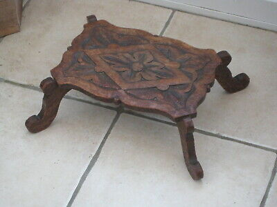 Delightful antique hand carved wooden foot stool