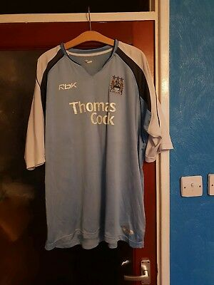 manchester city home 2004 bluereebok/thomas cook.adults large..