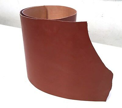 Vegetable tanned cow hide rich mid tan leather. 115 cm x 30 cm x 1.8 - 2.0 mm