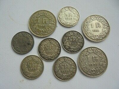 Switzerland, 9 - silver 1/2 & 1 Franc Coins as shown.
