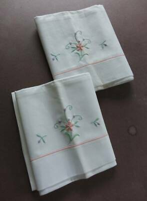 Pair UNUSED vintage white cotton pillowcases with pink  embroidery trim.