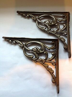 A stunning pair of silver colour metal brackets with bird design