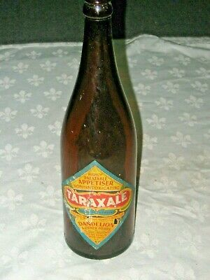 A Vintage 40's Amber Long Neck Embossed Script Labelled Taraxale Beer Bottle