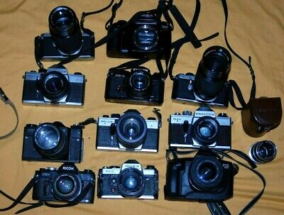 A Collection Of Vintage Film Cameras And Lenses #34