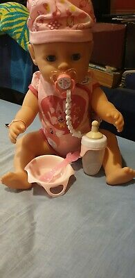 Baby born Girl Interactive doll With Blue eyes with accessories.