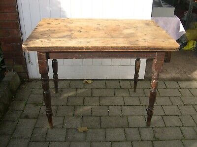 A vintage wooden table with attractively turned legs and single drawer.