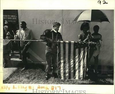 1983 Press Photo Walter Sandifer holds a flag at a Martin Luther King Jr. parade