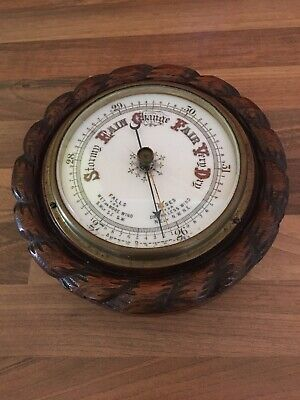 Antique Edwardian period Aneroid Barometer with carved Oak Case 17 cm across
