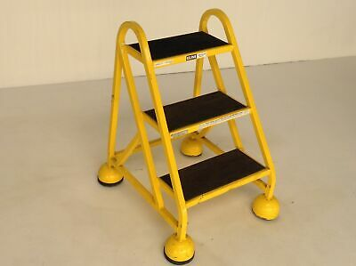 Uline H-969Y 3 Step Yellow Steel Step Ladder Spring-Loaded Retract Casters 1029