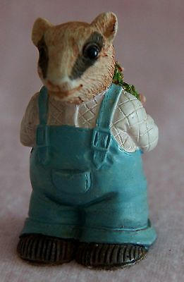 Badger Pottery Love Ornament Holding A Bouquet Pink Flowers Roses Behind Back