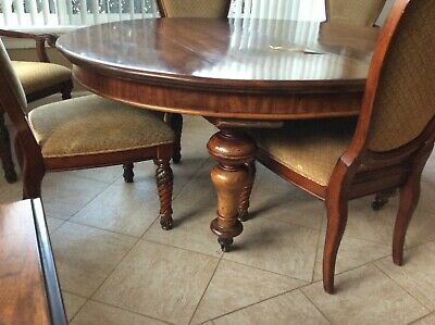 Dining room table with insert. Wheels attached