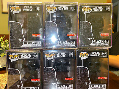 Darth Vader Futura Target exclusive funko pop with hard stack in hand.