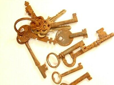 12 old, rusty keys:  6 skeleton type, 1 hollow tip with round head; 5 flat