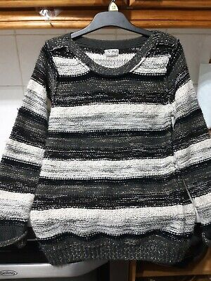 Lovely girls jumper from Next in black/grey/white & sliver thread age 9-10 years